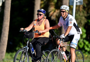 "Helena Adorno (left), mother of bicyclist Kevin Adorno (both of Farmington Connecticut) who was killed in September 1, 2014 in Vero Beach, is helped riding south along A1A from by Charles Sanford, of Vero Beach, during the first day of the Ride to the Finish bike ride from Vero Beach to Miami in memory of her son. Kevin Adorno died after being attacked by a homeless man at a McDonalds in Vero Beach while bicycling from Maryland to Miami. ""The first few miles were very humbling because I just related to him [Kevin] totally being on the bike coming down the coast,"" Helen Adorno said. ""I can see why people love biking."" (ERIC HASERT/TREASURE COAST NEWSPAPERS)"